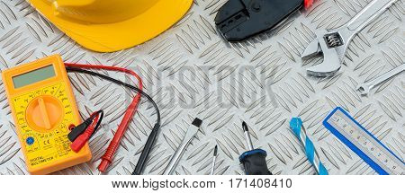 Wrenches, Screwdrivers, A Multimeter, Other Tools On Steel Checker Plate