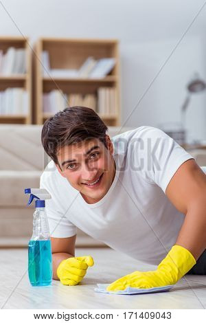 Man husband cleaning the house helping wife