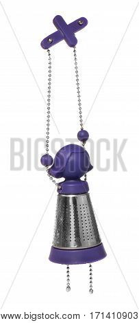 Purple and silver tea infuser in the shape of a girl on a chain. Tea kettles hanging on a white background.