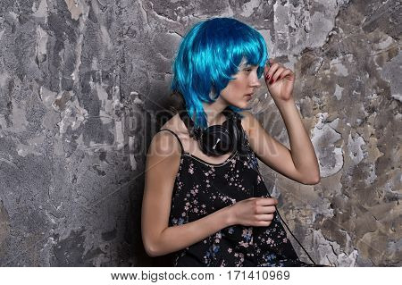 Pretty Girl In Blue Wig In Musical Headset