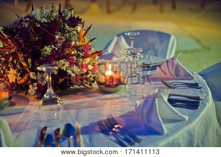 Romantic Dinner Setting On The Beach At Sunset