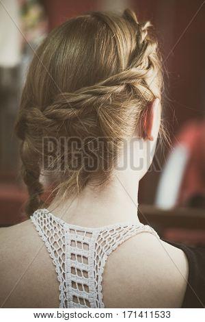 blonde woman hair with braid closeup back view