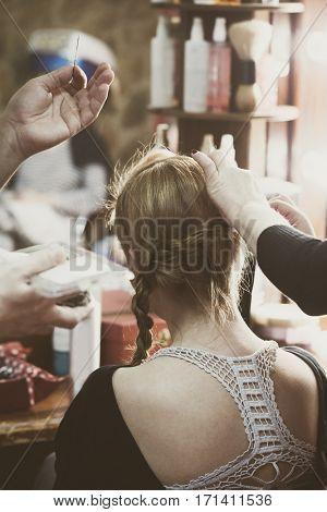 making hair braids in hair studio back view