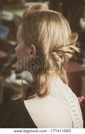 modern loose  braided woman hair closeup