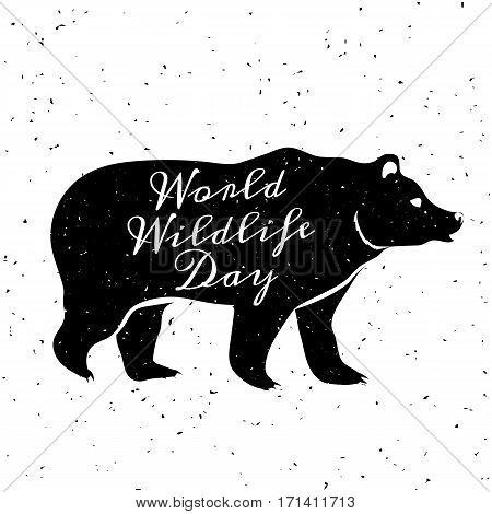 World Wildlife Day, 3 March. Grunge background with black silhouette of bear and lettering