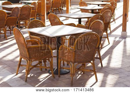 Wooden tables in a outdoor restaurant photo