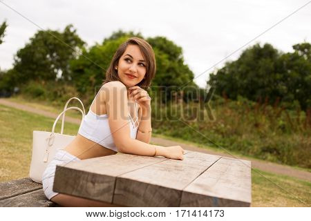 a young woman relaxing in the park
