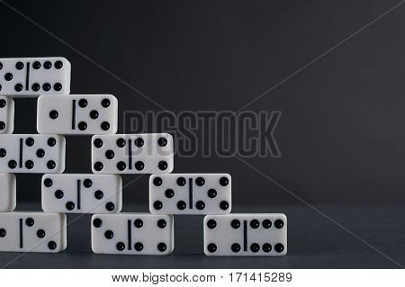 Tower of white domino play pieces Copy spase