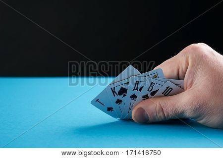 Hand of royal flush pocker cards .Closeup .