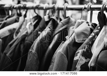 Black and white art photography monochrome old retro military uniform hanging in the closet. Men's stylish jacket.