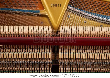 Close up of mechanics inside of an upright piano