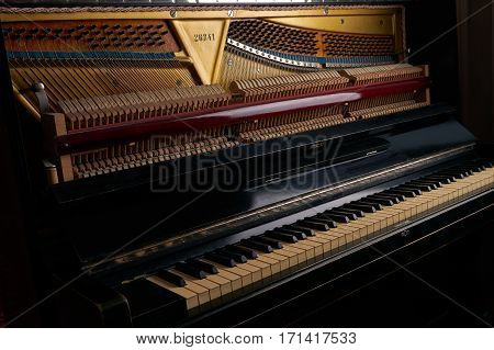 mechanics inside of an old upright piano