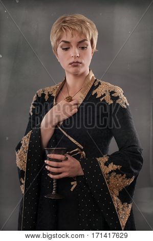 Renaissance Fashion Woman Holding Goblet With Wine