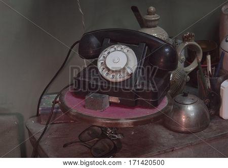 Vintage telephone on the Desk interior, glasses