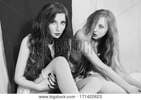 Black and white art photography monochrome girl and a blonde. Two lesbian women. Fetish model.