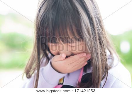 cute little girl get cold and feel vomit asian