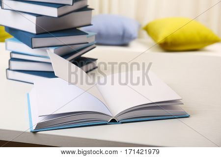Books on white wooden table