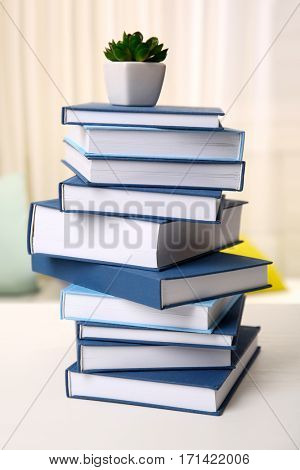 Stack of books on white wooden table