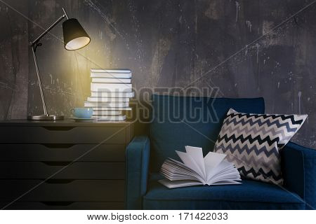 Book on armchair in room