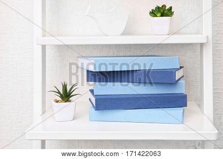 Books on white shelf at home