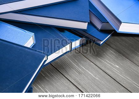 Books on grey wooden table