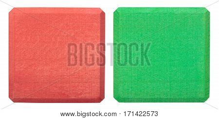 Red and green wooden blocks isolated on white. Flat lay