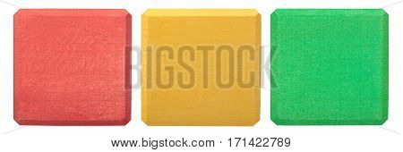 Red yellow green wooden blocks isolated on white. Flat lay