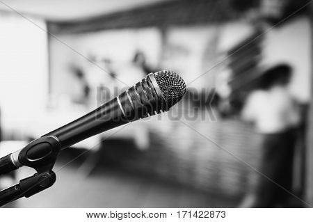 Black and white art photography monochrome microphone on a dark background. Evening in the restaurant. Conduct performance