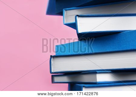 Blue books on pink background