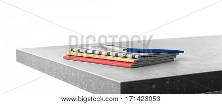 Copybooks with pen on table