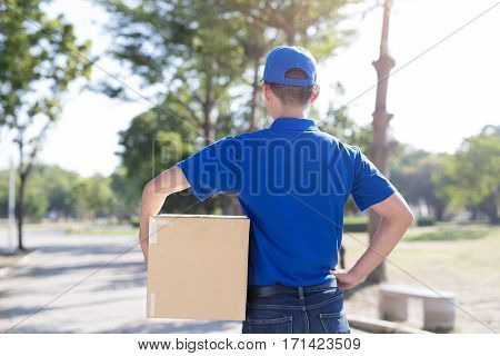 deliveryman stand and back to you asian