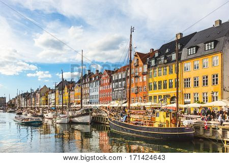 Colorful Houses In Copenhagen Old Town At Sunset, With Boats And Ships In The Canal In Front Of Them
