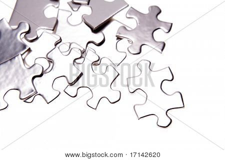 Jigsaw puzzle pieces over white