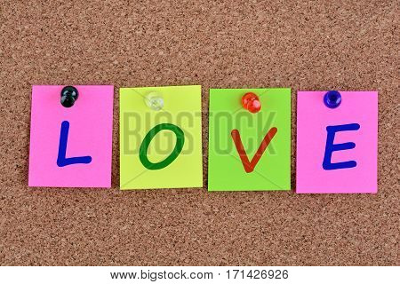 Love word on colorful notes close up