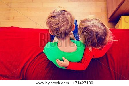 little brother and sister hug at home, family concept