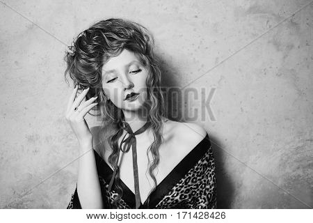 Black and white art photography monochrome girl with lips in leopard print gown with long hair. Bright unusual appearance