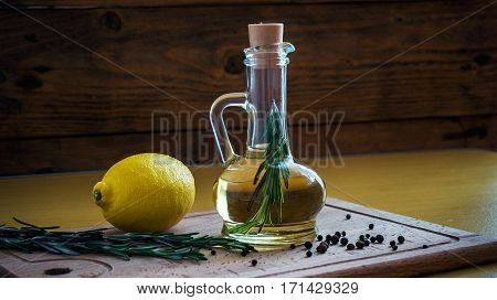 Olive Oil Bottle Still-life Over Dark Background