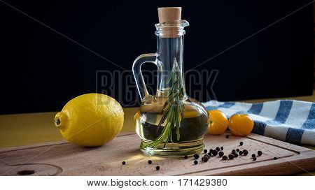 Olive Oil With Rosemary Branch. On A Wooden Background