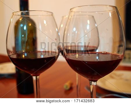 Red wine into the glasses for a festive meal in a restaurant