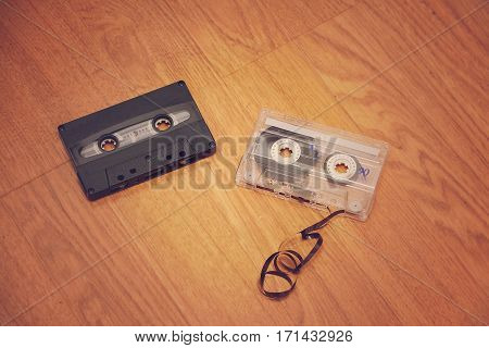 Cases of bygone days. The old cassettes lie on the floor.