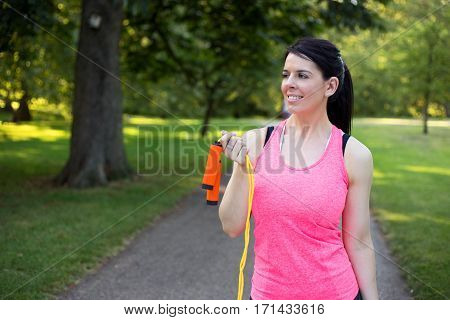 a young woman holding a skipping rope