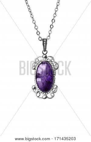 Vintage amethyst medallion on a chain isolated over white