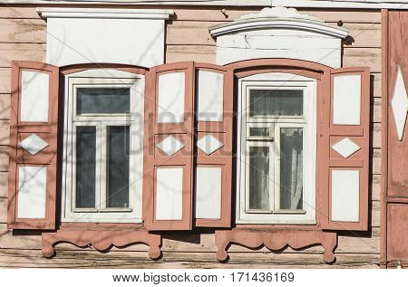 Carved wooden decorative lace decoration windows. Old wooden house. Irkutsk, Siberia, Russia