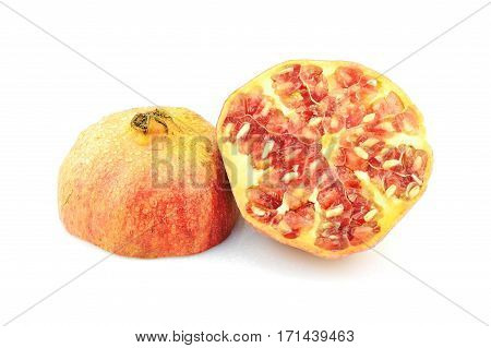 Pomegranate with seeds on white background. Half of exotic fruit. Natural antioxidant. Tasty bio product.