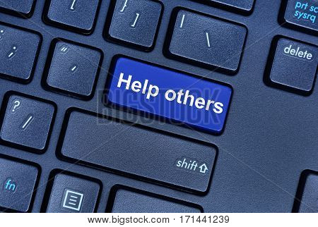 Help others words on computer keyboard button closeup