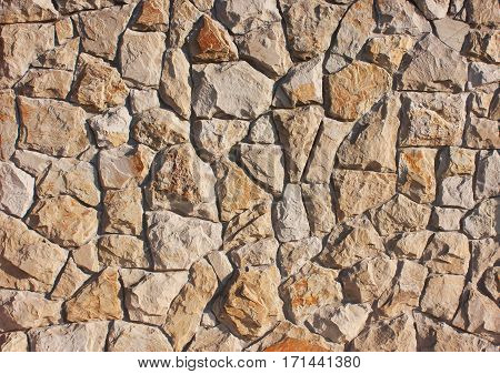 Background of brown red stones in a chaotic manner style of antique medieval concrete texture