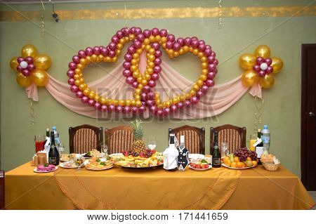 Festive wedding table glasses of champagne sandwiches with caviar snacks food pineapples hearts love