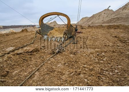 The excavator bucket dragline a volume of 10 cubic meters in a clay quarry near the town of Pology in the Zaporizhya region of Ukraine. November 2005