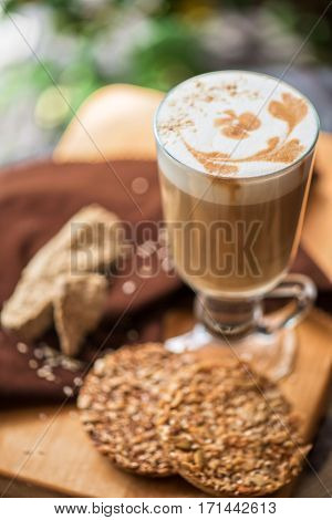 coffee latte cup with cookies closeup