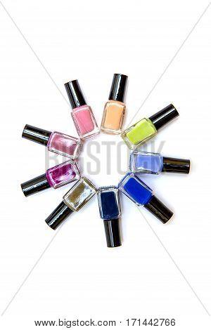 Coloured Nail Polish Bottles Stacked Circle On A White Background